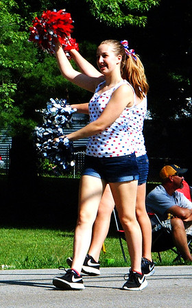 Debbie Blank | The Herald-Tribune<br /> Milan High School students used pompoms to rev up the crowd and lead the band.