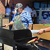 Debbie Blank | The Herald-Tribune<br /> Batesville Veterans of Foreign Wars members Steve Goerflein (left), Morris, and Harry Wilson, Greensburg, grill burgers as VFW Day gets underway at Kroger June 30.