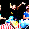 Debbie Blank | The Herald-Tribune<br /> One parade participant is proud to be a Milan 12 and under softball champ.