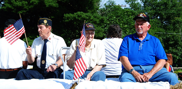 Debbie Blank | The Herald-Tribune<br /> Veterans waved at the crowd from two different floats at the Milan Lions Club Fourth of July Parade that began on the holiday at 10 a.m.