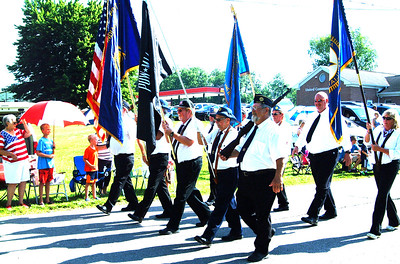 Debbie Blank | The Herald-Tribune Miltary veterans led the Milan Lions Club Fourth of July Parade, displaying appropriate flags.