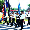 Debbie Blank | The Herald-Tribune<br /> Miltary veterans led the Milan Lions Club Fourth of July Parade, displaying appropriate flags.