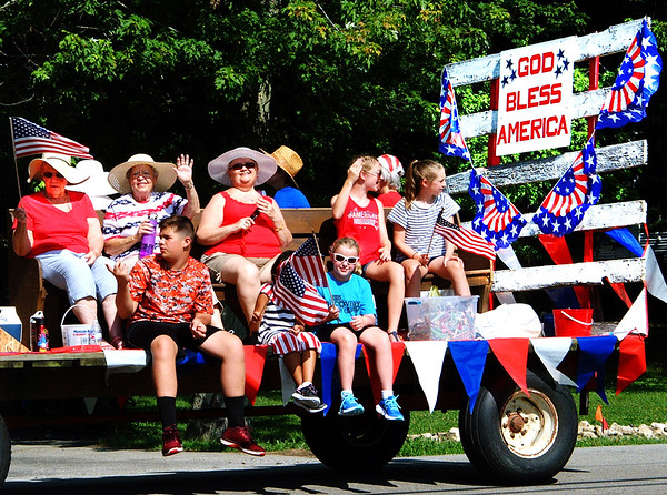 Debbie Blank | The Herald-Tribune The St. Charles Catholic Church float stood out among many businesses and candidates represented in the procession.