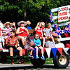 Debbie Blank | The Herald-Tribune<br /> The St. Charles Catholic Church float stood out among many businesses and candidates represented in the procession.