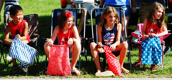 Debbie Blank | The Herald-Tribune<br /> July 4 was a red-white-and-blue day for (from left) Max Schaefer, 6, Batesville, and his cousins Chloe, 9; Brinley, 8; and Sophie Andrew, 5, Milan, at that town's parade.