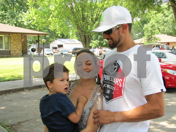 Drake and Melanie Jacobson and Justin Hayes after the parade in Otho.