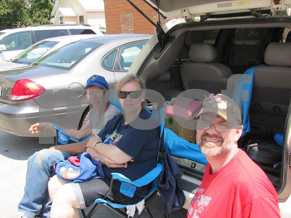 Carl and Jean Graffunder and their son Carl Jr. had a shady spot to watch Otho's 4th of July parade.
