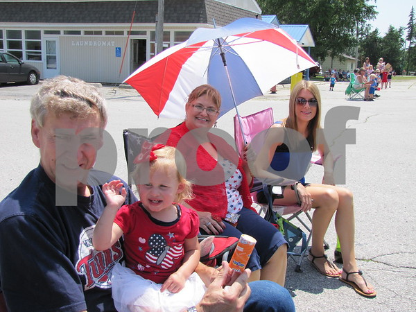 Duane Dornath, Kaylee Pugh, Mary Dornath, and Ashley Pugh at the parade in Otho on the 4th of July.