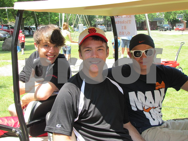 Jonathon Bouden, Grant Hendrix, and Logan Ulstad sold raffle tickets to raise funds for the Fort Dodge Dodgers Cheerleaders.  The young men drove their decorated golf cart in the Otho parade with the Fort Dodge Dodgers Cheerleaders.