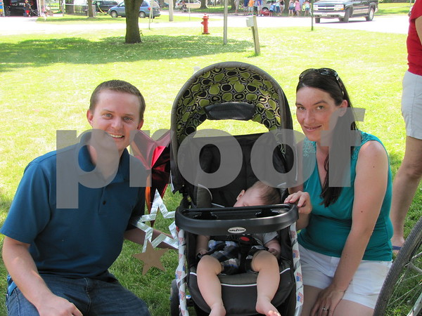 Nathan and Stephanie Teague with their son Hunter, asleep in the stroller, after the parade.