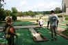 Lisa, Brock, Morgan and Dan playing putt putt golf