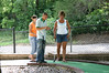 Erin, Alex and Lori playing putt putt golf