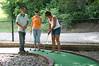 Alex, Erin and Lori playing putt putt golf