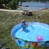 Lexi plays in her pool on the fourth of July at the lake house ( 2012 )