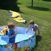 Max and Lexi play in the pool over the 4th of July at the lake house ( 2013 )