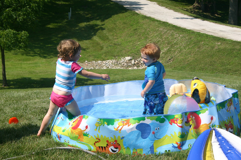 Lexi and Max play in the pool at the lake house over the 4th ( 2013 )