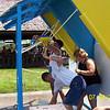 Lori, Todd and Lisa having a water balloon fight