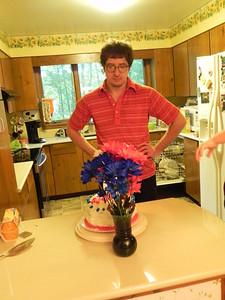 Brian regarding his cake