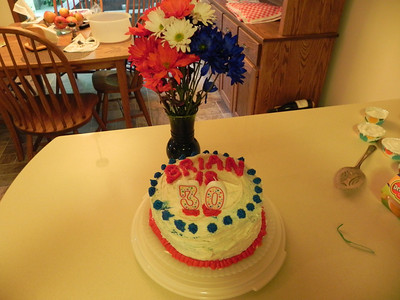 Birthday cake and flowers for the 4th
