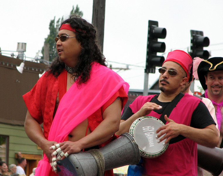 And belly dancers need their music, of course. I like the hot pink fez.