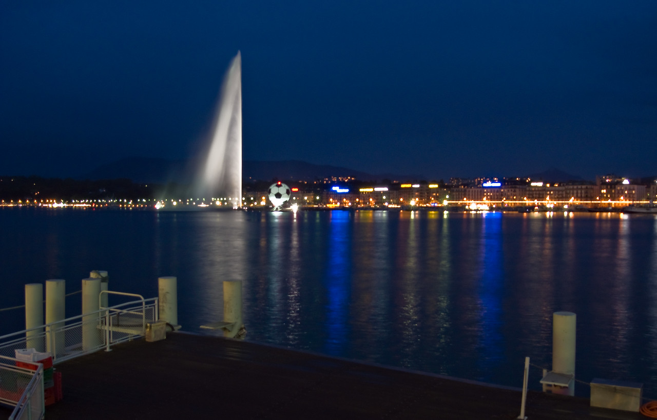 The Jet d'Eau at night. The giant football occasionally rose into the air, presumably powered by helium.