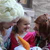 A young admirer with Katie Kelley and Jessica Martin from Hope Love and Magic at the Petaluma Gingerbread House Showcase & Competition Hosted by Hotel Petaluma on December 17th 2017. Victoria Webb for the Argus-Courier