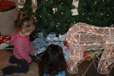 Girls checking out Presents 2008