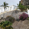 Buildings and gardens are perched on ledges on the cliffs around Puerto Rico.