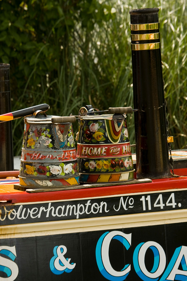 Stoke Bruerne narrow boats. painted buckets with chimney stack