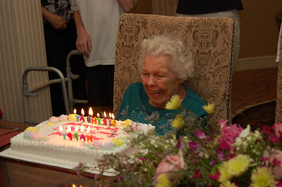 """She blew out the candles first try, then announced, """"Well, I'm still breathing!"""""""