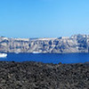 View towards Fira on Santorini viewed from the volcanic island