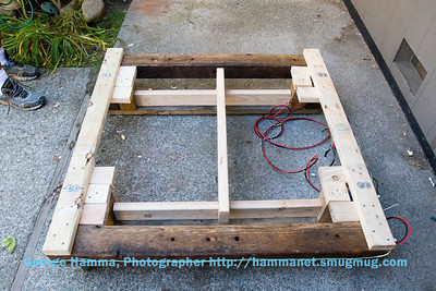 This is the rotation frame with the drop frame on the ground.  You can see the alignment blocks in position that restrict the up-down motion to make sure the steel blocks are properly aligned with the magnets when the stage is raised and the magnets are on.