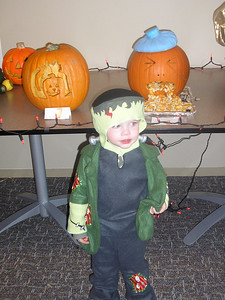 The Scary Frankenstein Monster standing in front of his favorite pumpkin, the one with the hangover...hmmmmm
