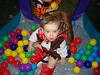 Reese playing in the balls at the birthday party
