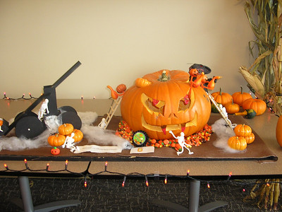 The Pumpkin Carving Contest at work, note the winner ribbon...that is Johanna's Pumpkin (honestly I did very little work, but it was fun!)