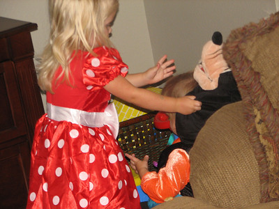 My niece, Haylee's biggest love of all is Mickey Mouse and crew.  She is Halloween Minnie Mouse.  And she kept wanting to make sure Garrett stayed completely in costume.