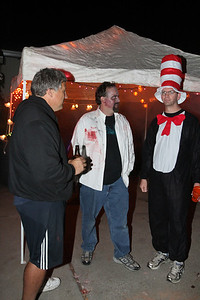 Larry (builder), Drew (host), and an appropriately garbed guest discuss how the evening is going.