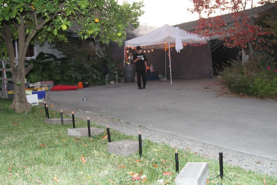 The graveyard is next to the driveway that leads to the reception tent.  The path to the Zombie Kitchen is next to the black area (garage door opening) behind the reception tent.