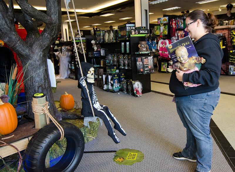 Kristina LeBlanc checks out a doll at Spirit Halloween in Lunenburg on Friday afternoon. SENTINEL & ENTERPRISE / Ashley Green