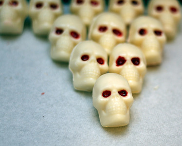 Making chocolate skulls for a Halloween party.