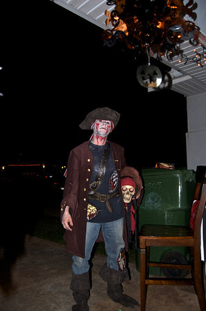 For a man who came to the party without a costume, he made it work. The pirate jacket is my wife's from the year before; everything else was scraps or makeup we came up with.