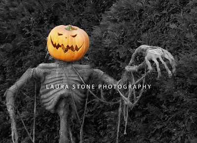 Spooky jack-o-lantern scarecrow