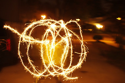 light match, light sparklers, tell boys to run, pick up camera and try to get a pix