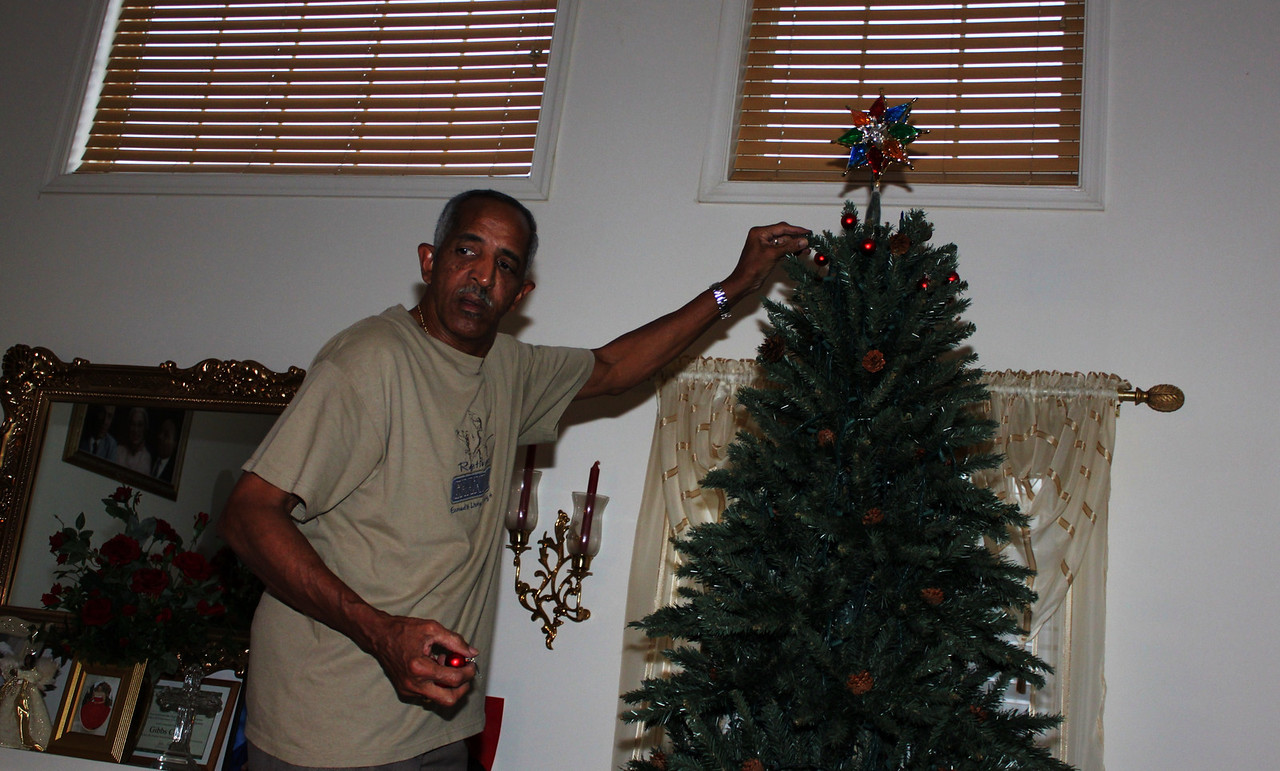 My Dad putting up the tree on Thanksgiving.