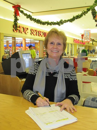 Norma Adson is available to assist shoppers with Crossroads Mall gift certificates.