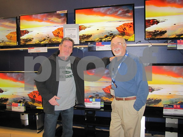 Tim O'Leary discusses TV's with Sears salesman Mike Moore.