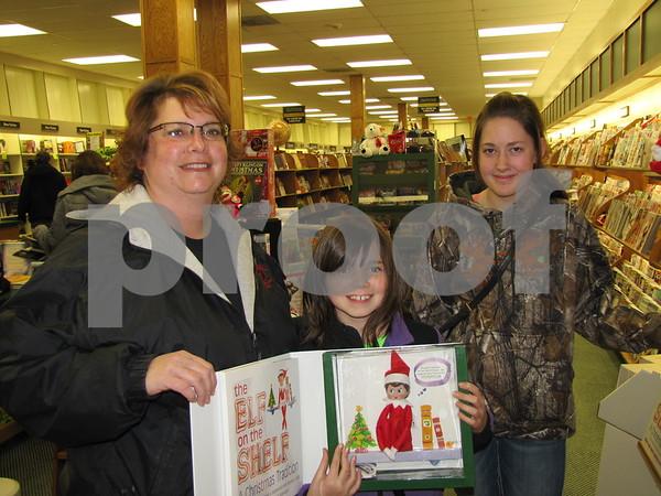 Darlene, Miranda (showing her newly purchased 'Elf on the Shelf', and Baylee Lindner.