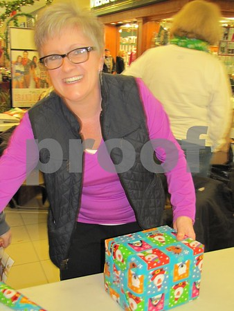 Shari Burke works in the gift wrapping booth of the St. Ed's French club.