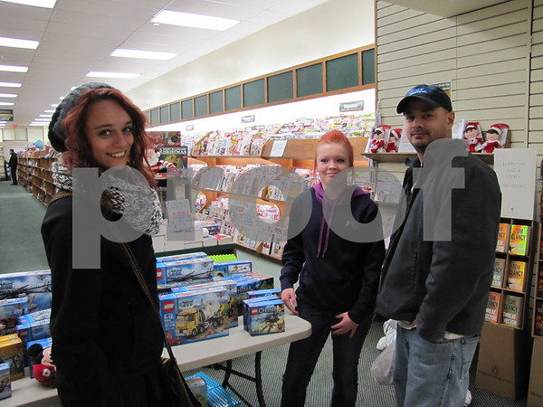 Mariah and Mercedes Smith, and Ed Burley check out the book store.