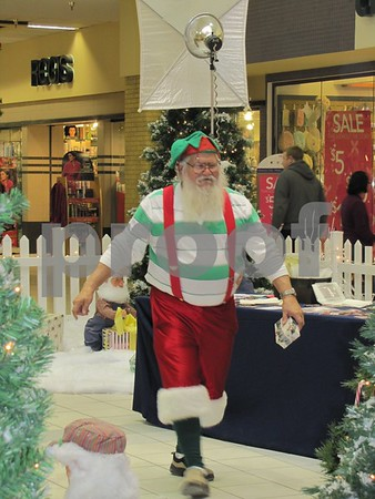 Santa's 'helper' was busy taking photos of the children who had come to see Santa.